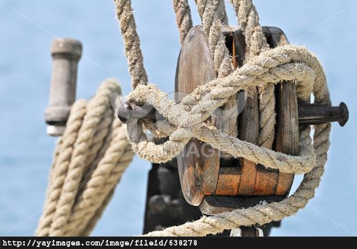 Close-up of a wooden block, winch and rigging of an old sailboat, image for sale a buck ninety five, follow link