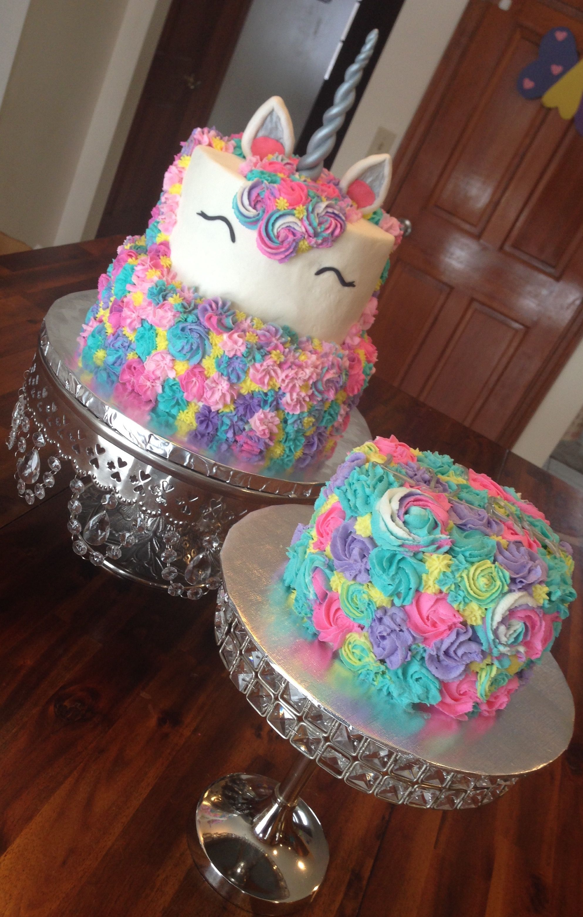Pretty rainbow pastel unicorn cake and matching smash cake I