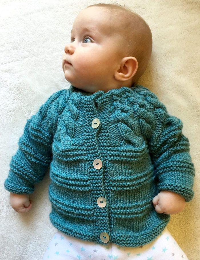 Free Knitting Pattern for Seastar Baby Cardigan - Long-sleeved baby cardigan sweater with a garter stripe pattern and a cabled yoke. Sizes 3-6 months, 12 months. Designed by Anne Dresow. DK yarn. Available in English and Danish