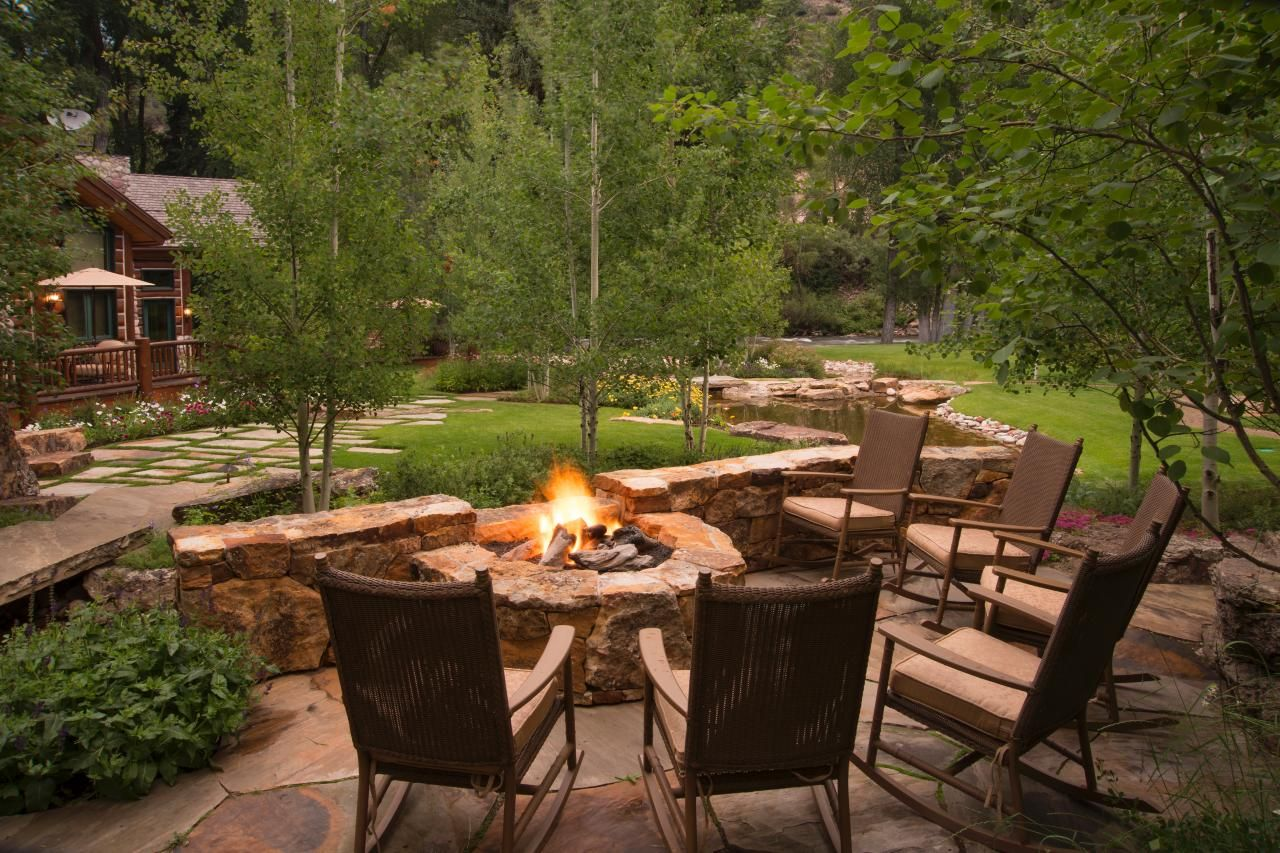 Best Outdoor Room | Rustic patio, Hgtv and Rocking chairs