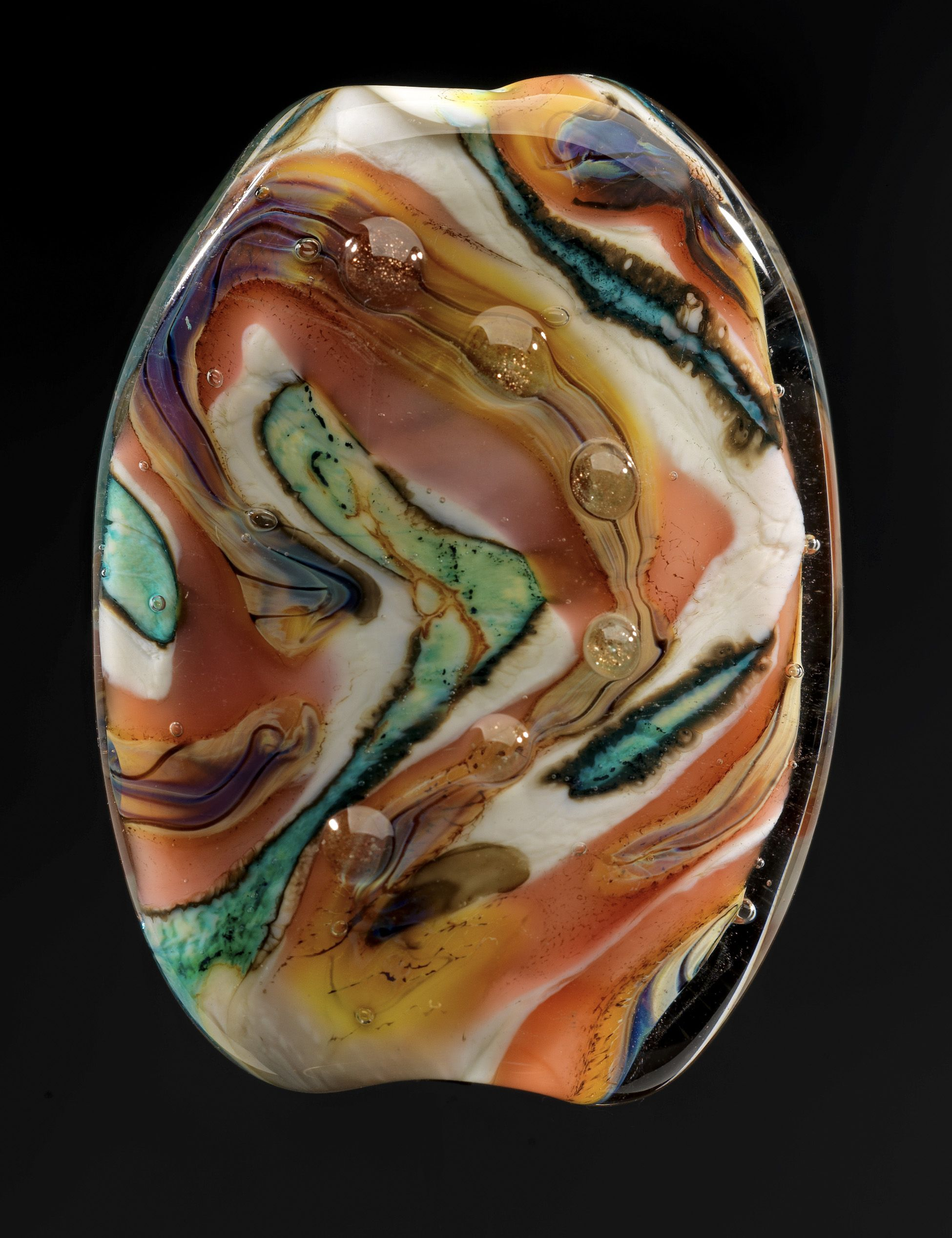 Learn how to make glass beads.  Flameworking Lampworking Created by Julie Lukosaitis   photo by Jim Carman
