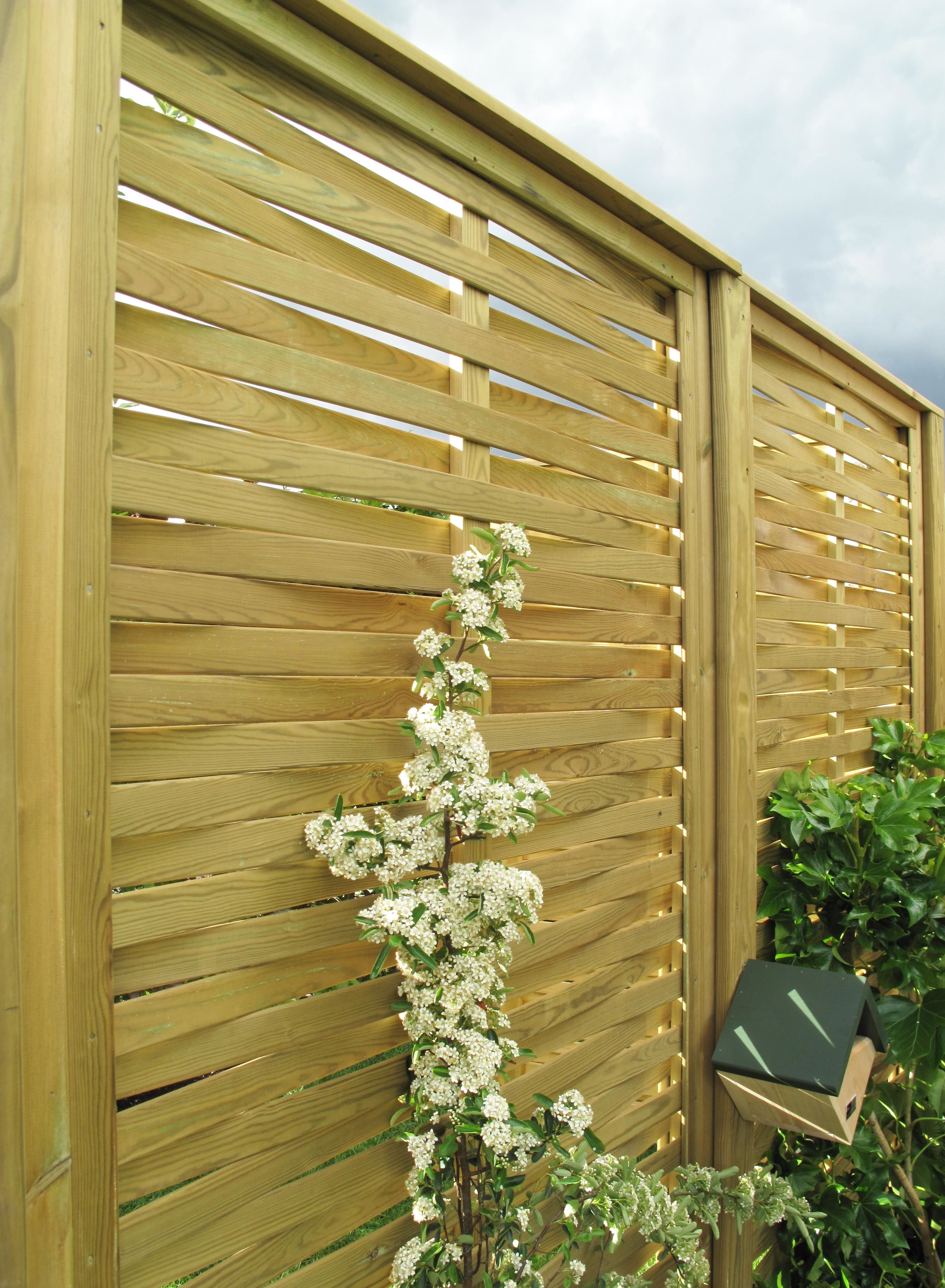 The woven fence panel may look like an old style inter