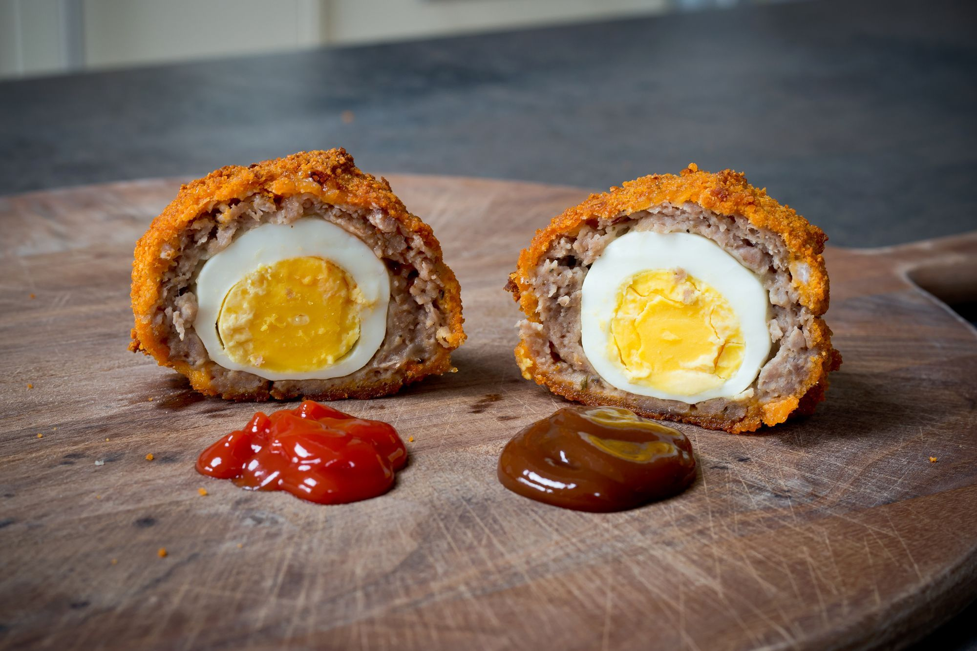 Baked Scotch Egg Recipe #scotcheggs Happy Easter! If you're looking for an alternative to chocolate eggs, here's our Scotch egg recipe. Oven baked, not fried! Please share this recipe if you think your friends would like it. #scotcheggs