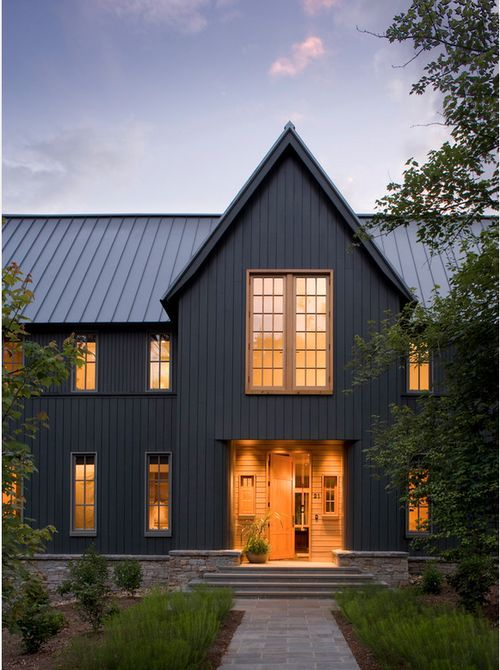 Dark Grey Vertical Siding And Steel Roof Make This Modern Farm House A Must See Paint Color Modern Farmhouse Exterior Gray House Exterior Black House Exterior