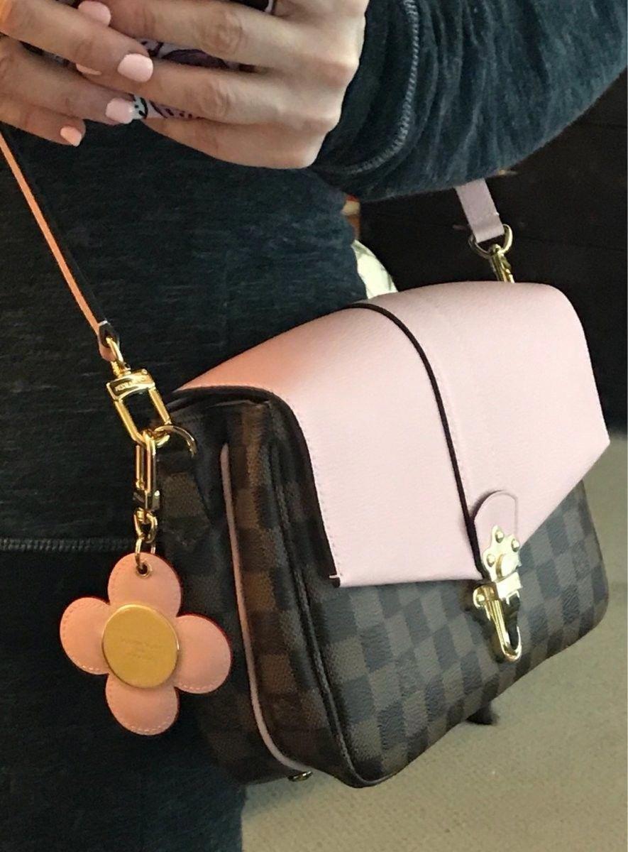 efb08b02ad82 Porte feuille et sac à main rose et noir Louis vuitton Nom du créateur Louis