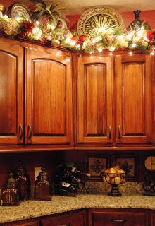 lighted garland above cabinets for some kitchen christmas festivity