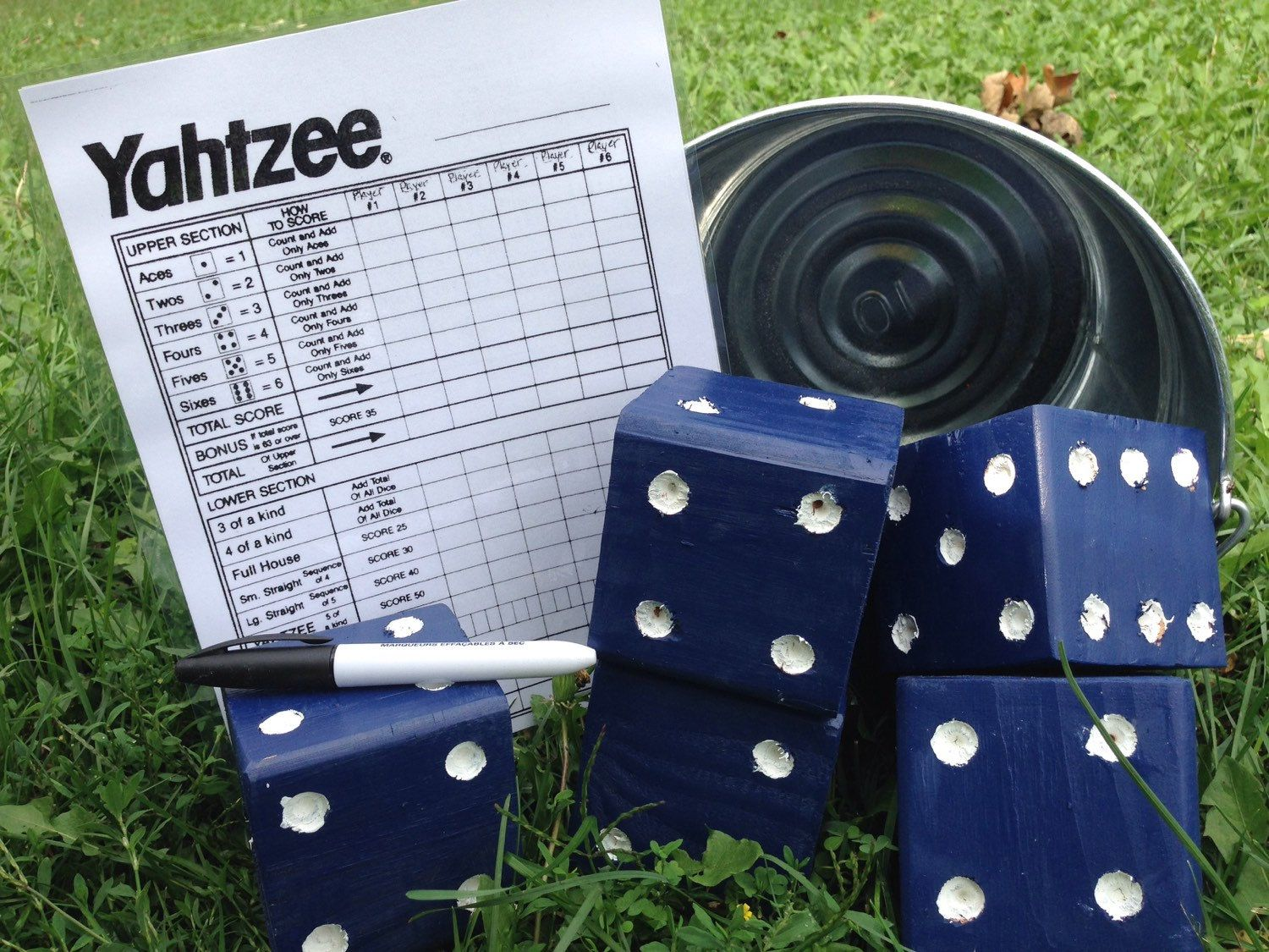 A personal favorite from my Etsy shop https://www.etsy.com/listing/244305575/yard-yahtzee-lawn-games-dice-game-frakel