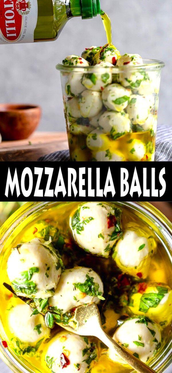EASY OLIVE OIL MARINATED MOZZARELLA BALLS #newyearsappetizers These Olive Oil Ma... - #balls #marinated #mozzarella #newyearsappetizers #olive #these - #MozzarellaAppetizers