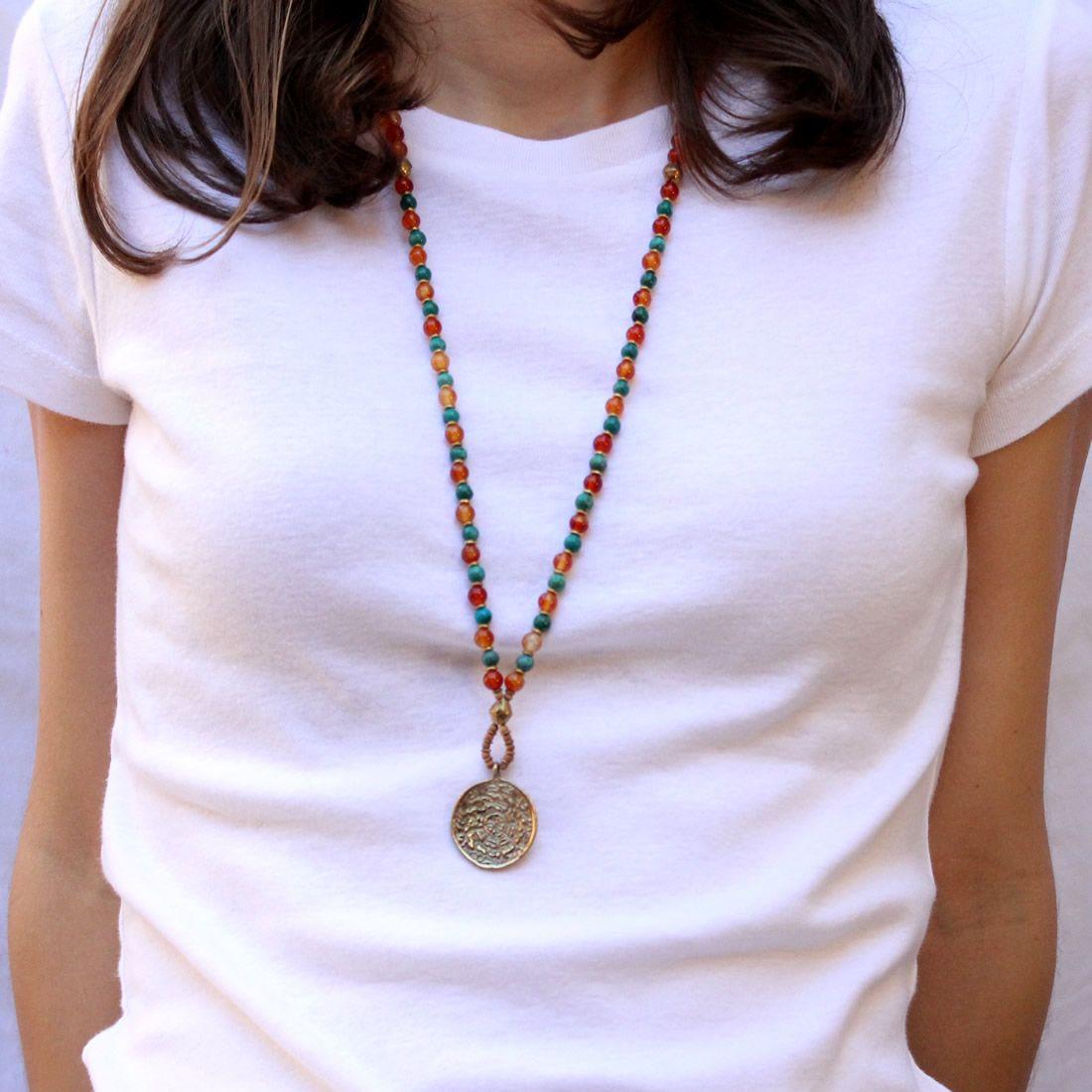 Carnelian and turquoise 108 bead mala necklace with Tibetan calendar pendant. #orange #necklace #malanecklace #loveprayjewelry
