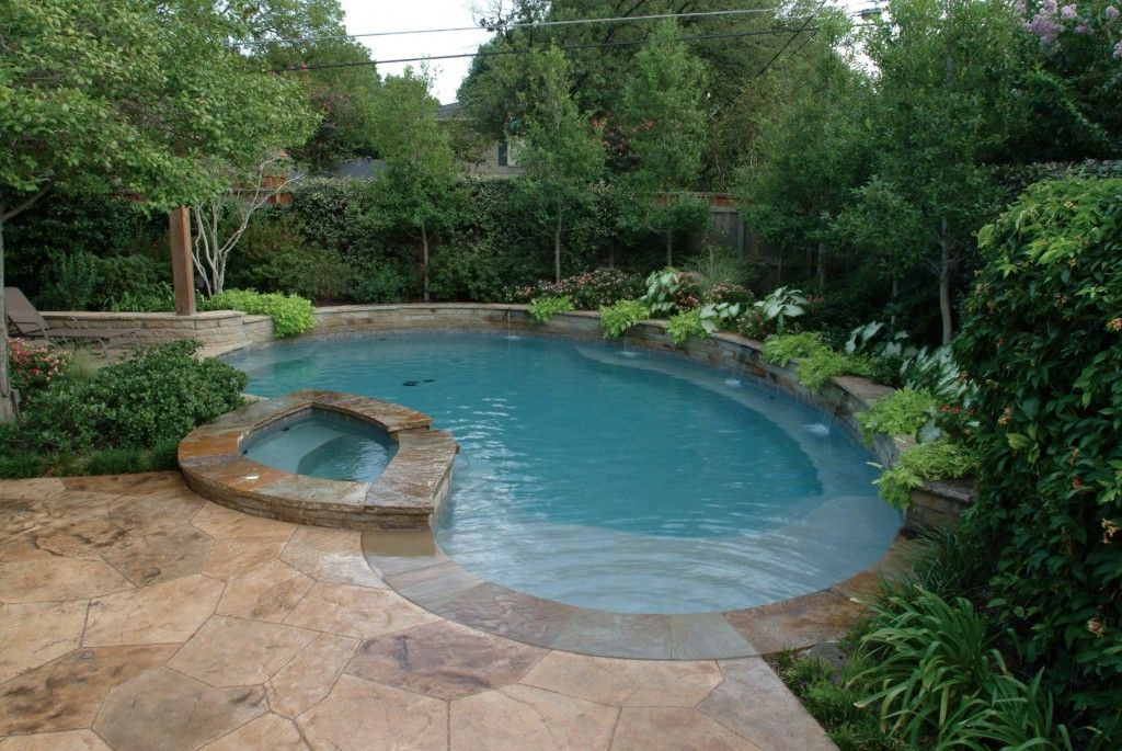 Overhead view of a pool and spa with a custom designed stamped ...