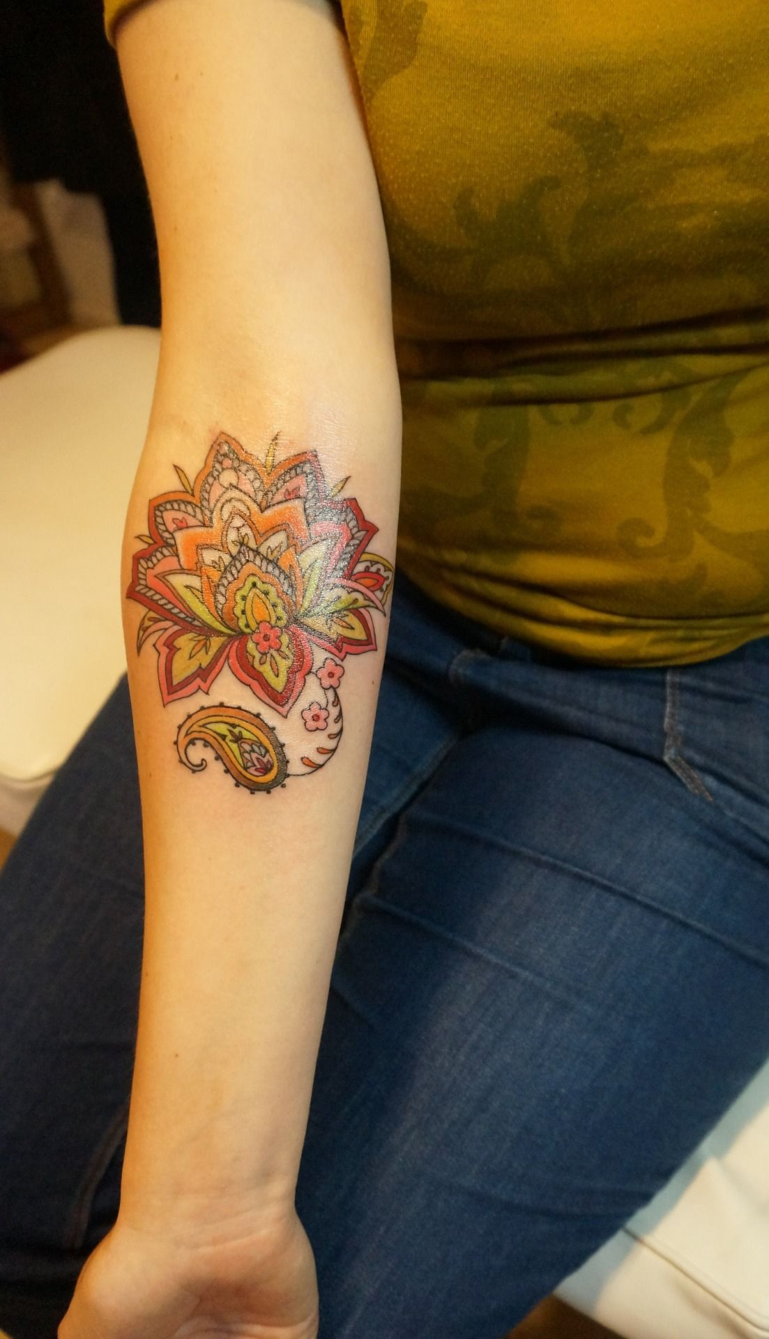 a lotus flower in henna/paisley style Colorful mandala