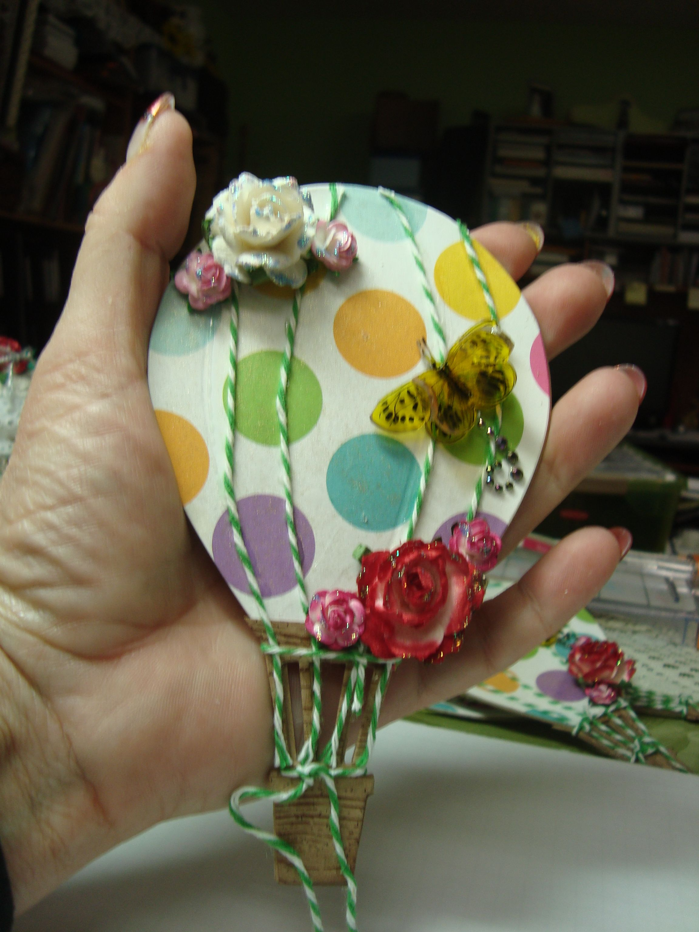March Your Paper Pantry tag swap, my Accucut balloon die for the tag, bakers twine and a shrinky dink 3D butterfly.
