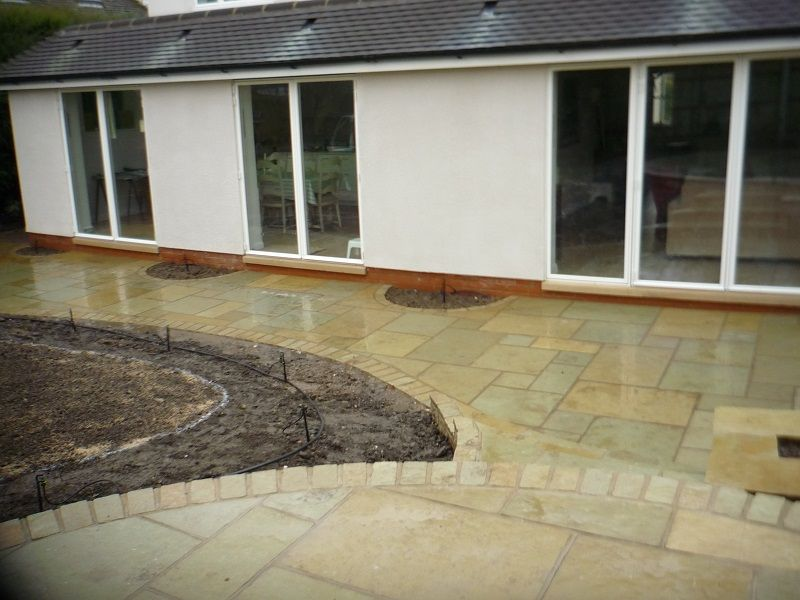 Patio Design With Semi Circular Planting Beds With Images