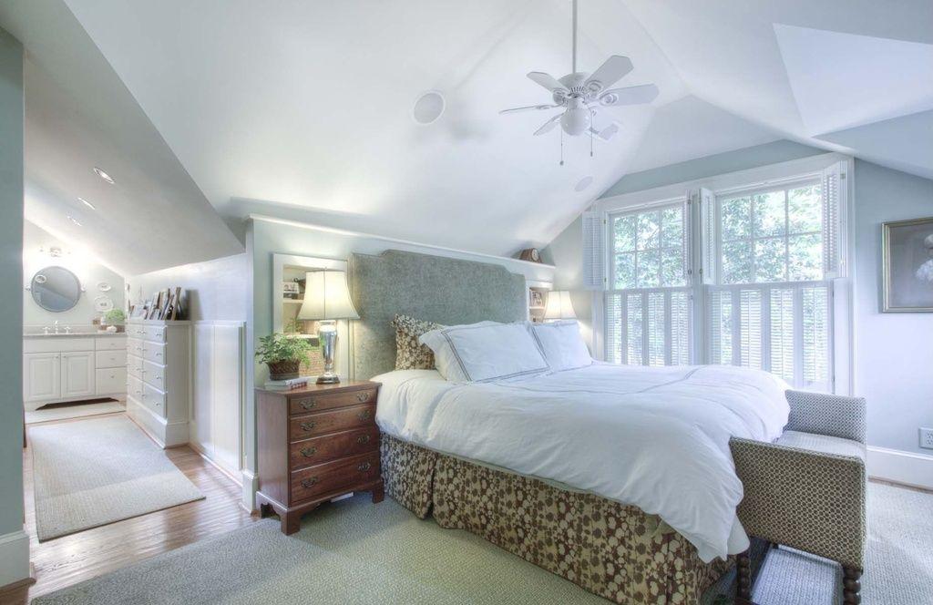 cottage guest bedroom with built in bookshelf carpet ceiling fan rh pinterest ca