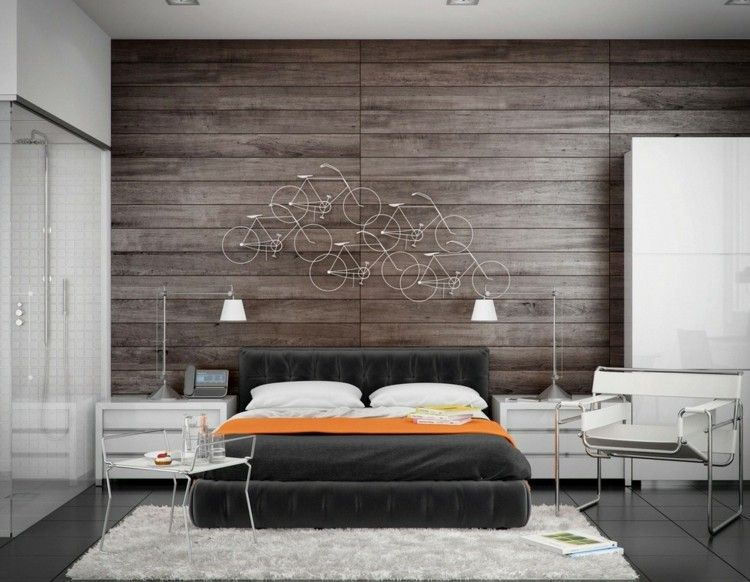 Modernes schlafzimmer mit origineller wanddeko und holzwand