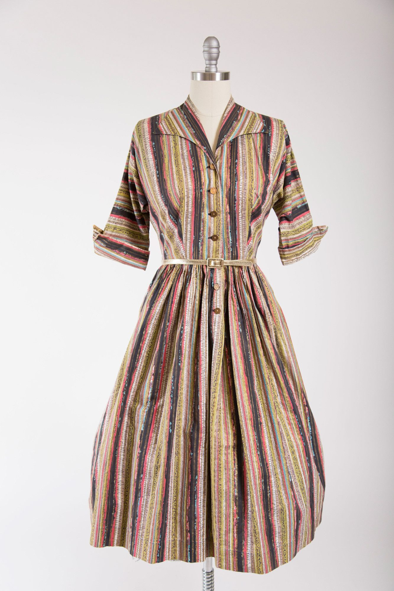 1950s vintage day dress. Made of a crisp cotton in a fantastic, striped mid…