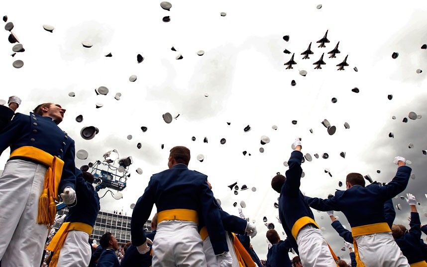 The Thunderbirds fly by as graduates celebrate at the US Air Force Academy commencement ceremony in Colorado Springs.