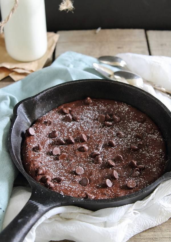 Paleo brownies made in a cast iron skillet - coconut oil, dark chocolate chips, mashed banana, vanilla extract, eggs, tapioca flour, coconut flour