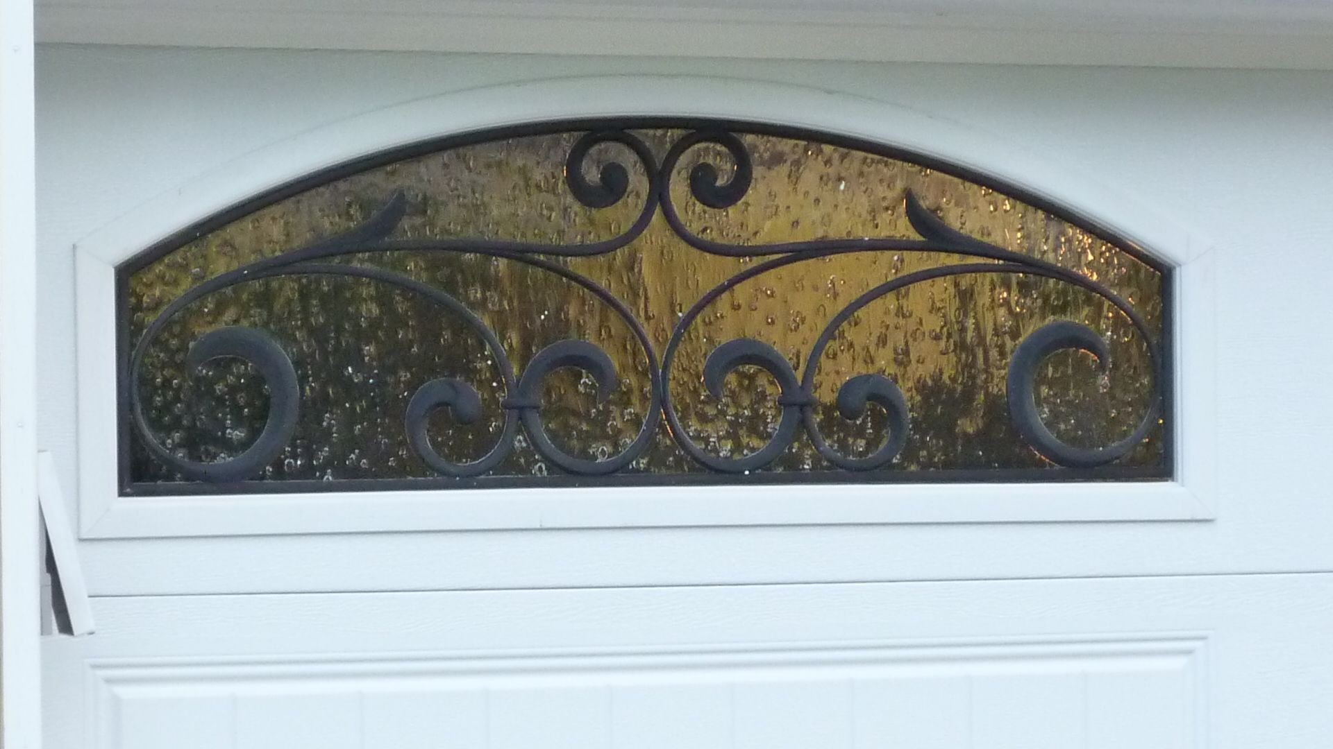 Detail Of A Decoarive Wrought Iron Window Option On Clopay