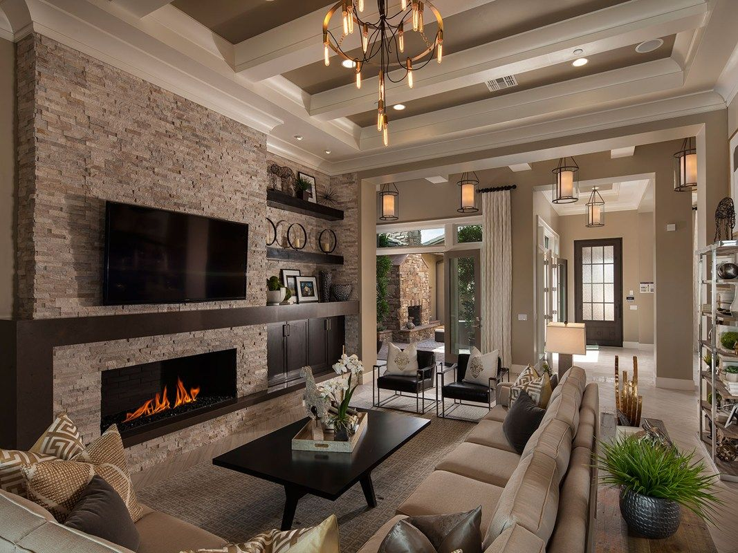 A dramatic coffered ceiling defines this great room that - Feature walls in living rooms ideas ...