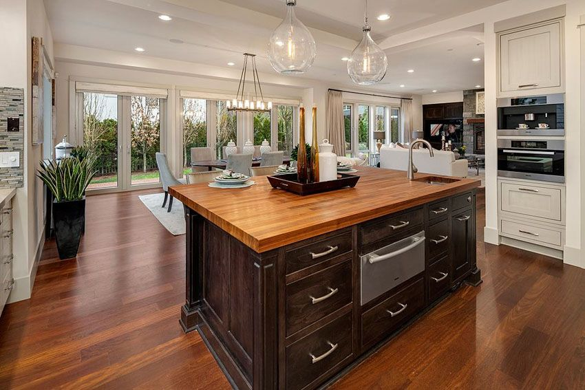 Kitchen Island With Wood Countertop, Dark Cabinet And Hickory Floors