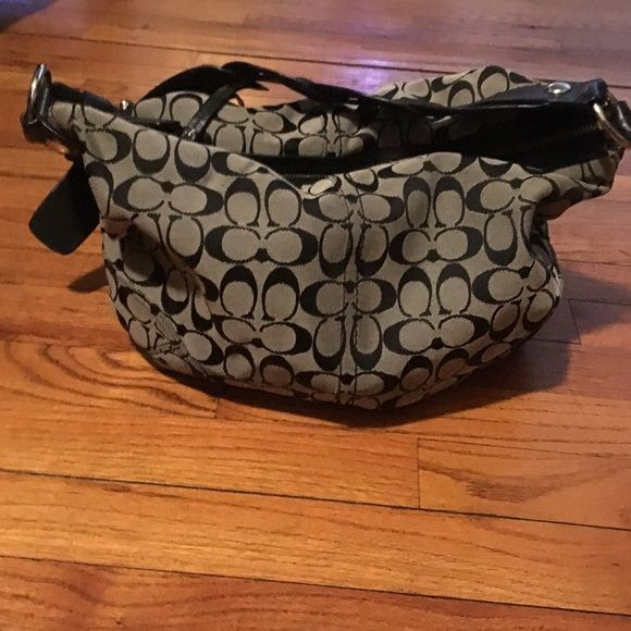 ⚜⚜Authentic COACH Hobo Bag used once for 2 hr's⚜⚜ ⚜⚜Authentic COACH Two Toned Signature fabric hobo bag in BLACK with a braided leather adjustable shoulder strap!!! Literally brand-new used for ONLY 2 hours and put back in its DUST BAG just to big for my liking! Comes from a pet and smoke free home same day or next day shipping depending on the time it's ordered Open to offers please use the offer button and no lowballing thank you please feel free to ask any questions⚜⚜ Coach Bags Hobos