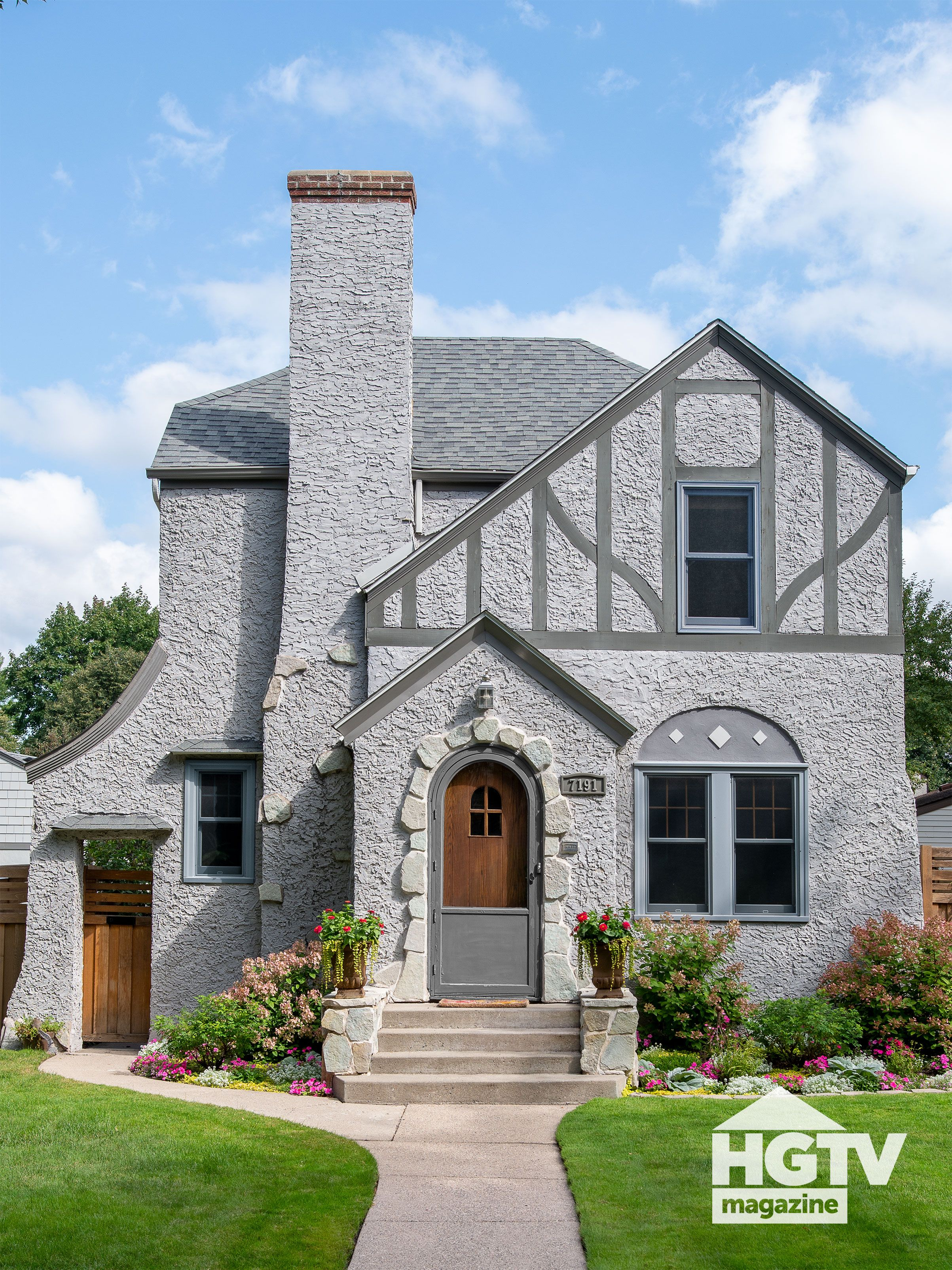 An American Tudor Featured In Hgtv Magazine In 2020 Curb Appeal Brick Decor Painted Front Doors