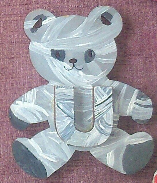 it's a 'mummy' bear. covered in bandages. waiting by ArtZeeboze