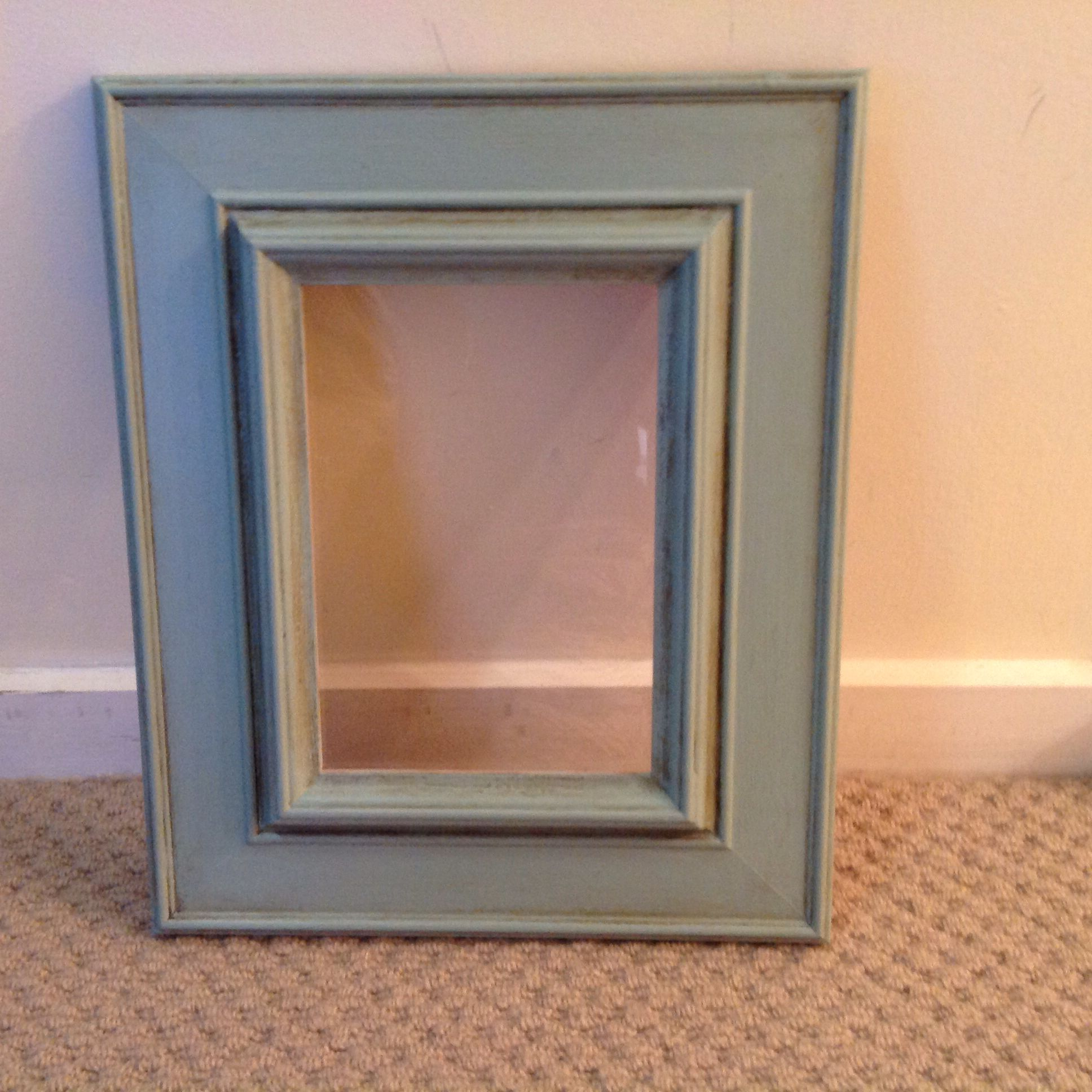 Frame with light application of dark wax.