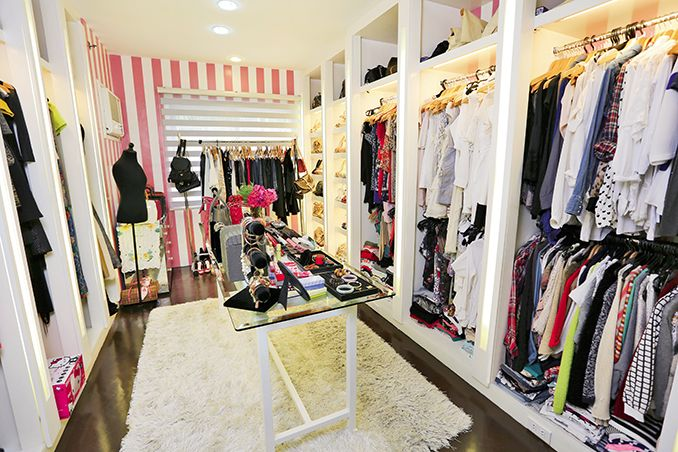 Pink and white stripes on the accent wall give her walk-in closet a girly touch%u2014without being too frilly.�