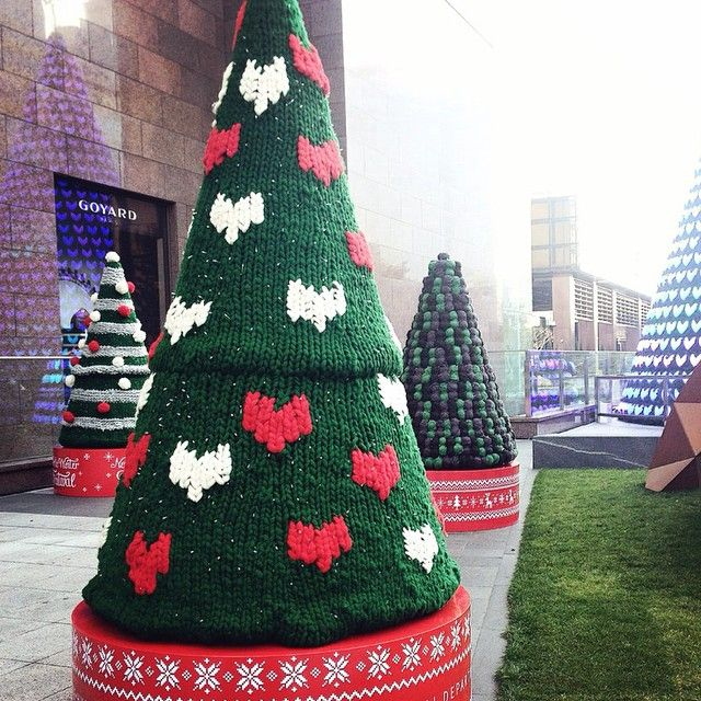 Knitted...Christmas....Trees...   You could probably roll them up like socks for the year when you're done with them! LOL