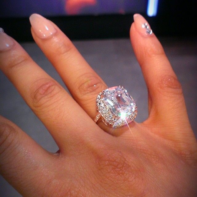 How expensive are wedding rings. DANG!!! HOW CAN YOU HOLD YOUR FINGER UP WITH THAT ROCK ...