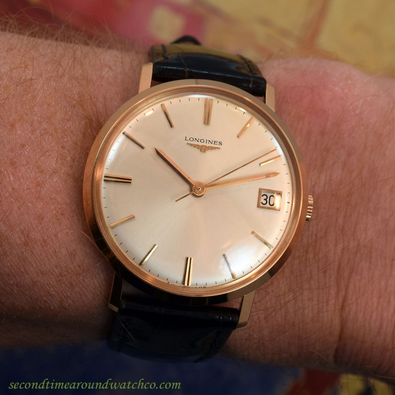ffe0f0ec542 A 1967 Vintage Longines 18K Rose Gold watch with a silver dial
