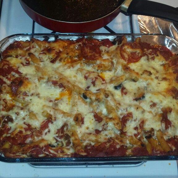Finished Product.. Baked Pepperoni pizza spaghetti w/ motzerella/ pepper jack cheese and black olives.. #FoodPorn #MouthGasm #CheeseForDays #BeardedChef #InTheKitchenLike #BatCave #Flexin