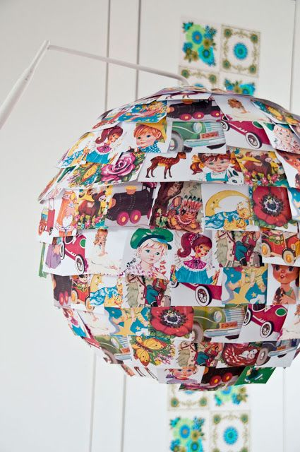 Paper lantern covered with vintage children's book illustrations
