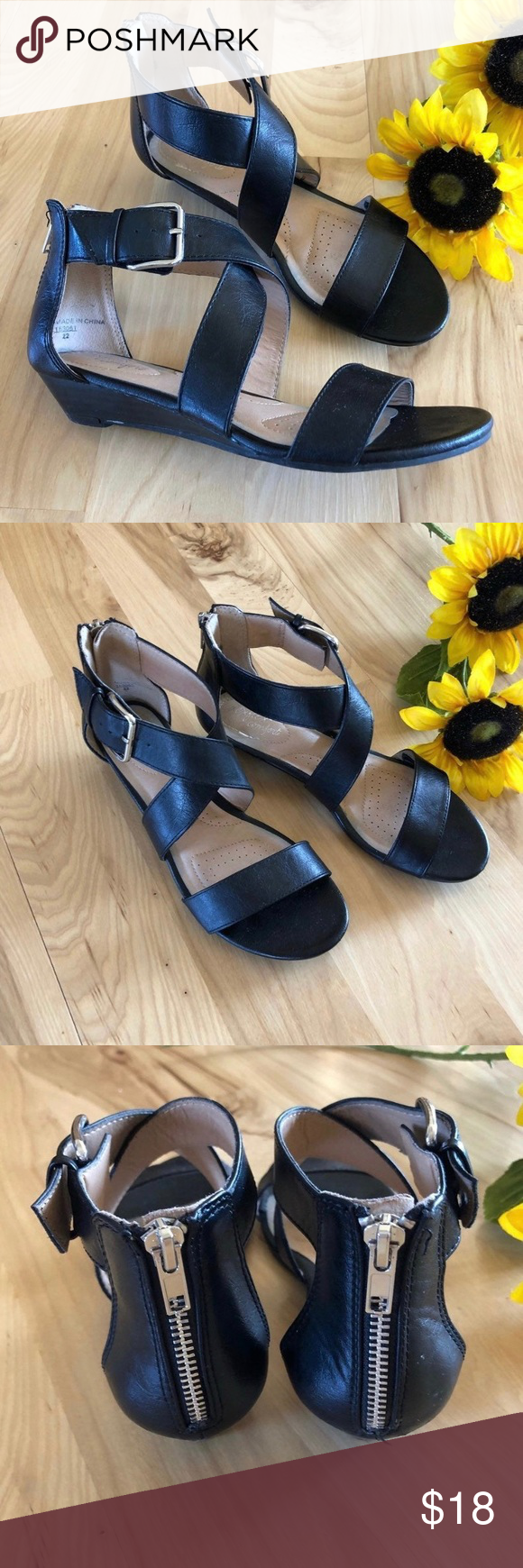 Women's Black Strappy Low Wedge Sandals Women's Black Strappy Low Wedge Sandals   SIZE: 9 CONDITION: Like-new, Pre-owned COLOR: Black  PRODUCT DETAILS: Versatile and comfortable, the Valerie Wedge sandal features a strappy, tumbled upper, ankle zip, low 1 heel, and a rubber outsole.   • Low 1 Heel  • Black Straps   • Ankle Zipper  • Rubber Outsole  Condition: Like new Shoes Wedges #lowwedgesandals