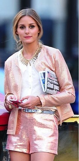 Olivia Palermo, killing it, as usual in shimmery peach jacket and shorts combo