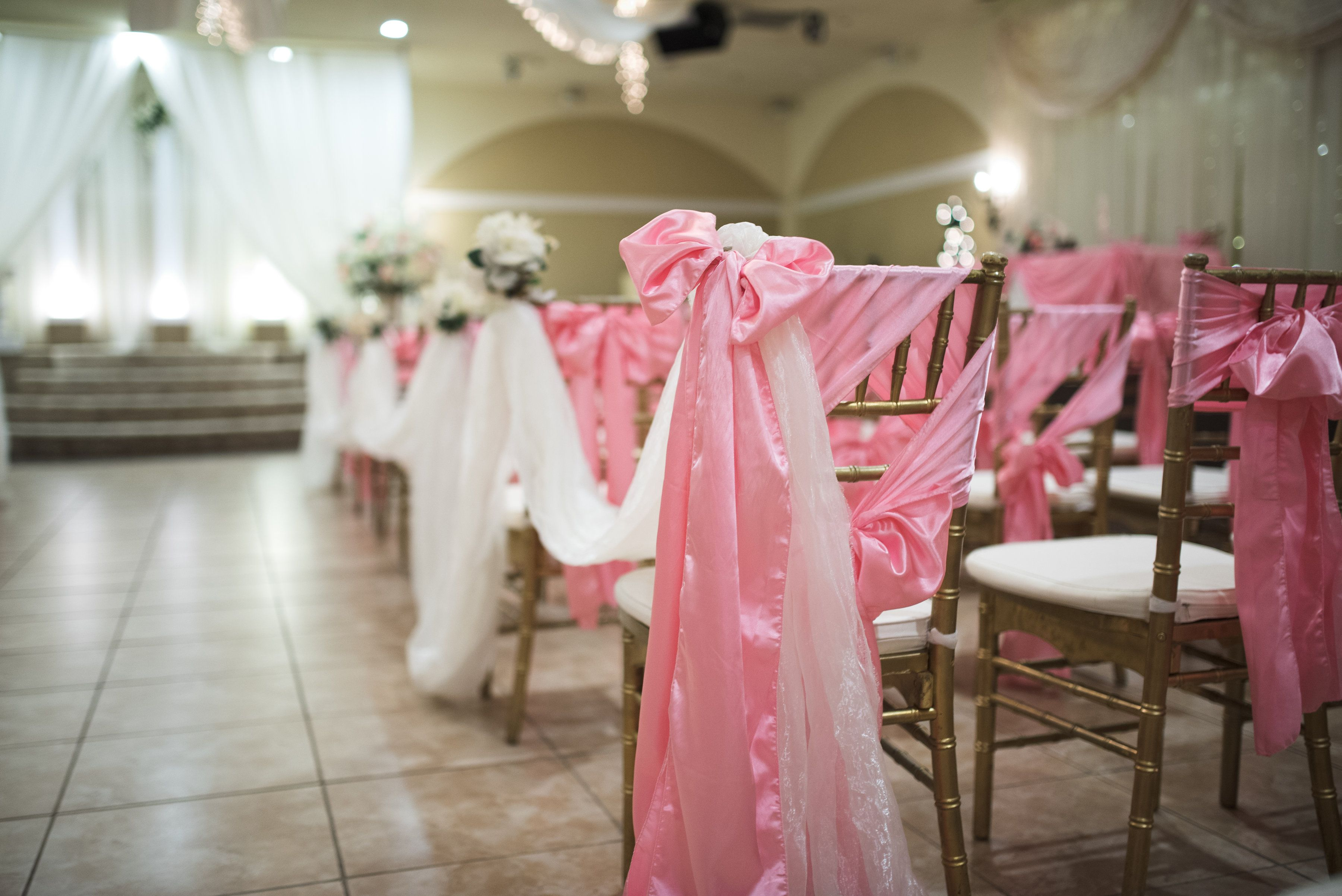 Chairs set up with pink ties for the indoor ceremony | Arizona ...