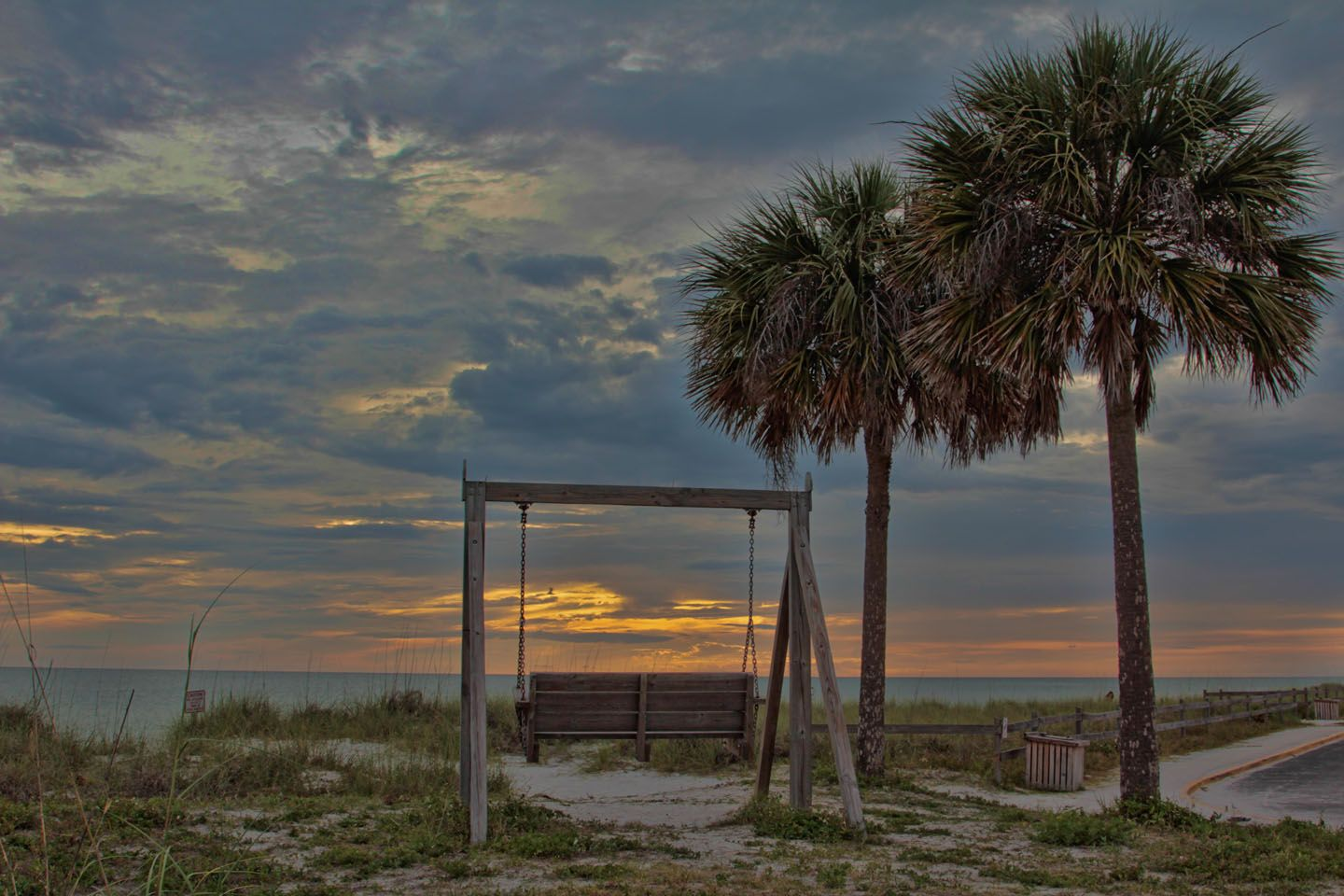 Swing and palms at honeymoon island state park honeymoon island