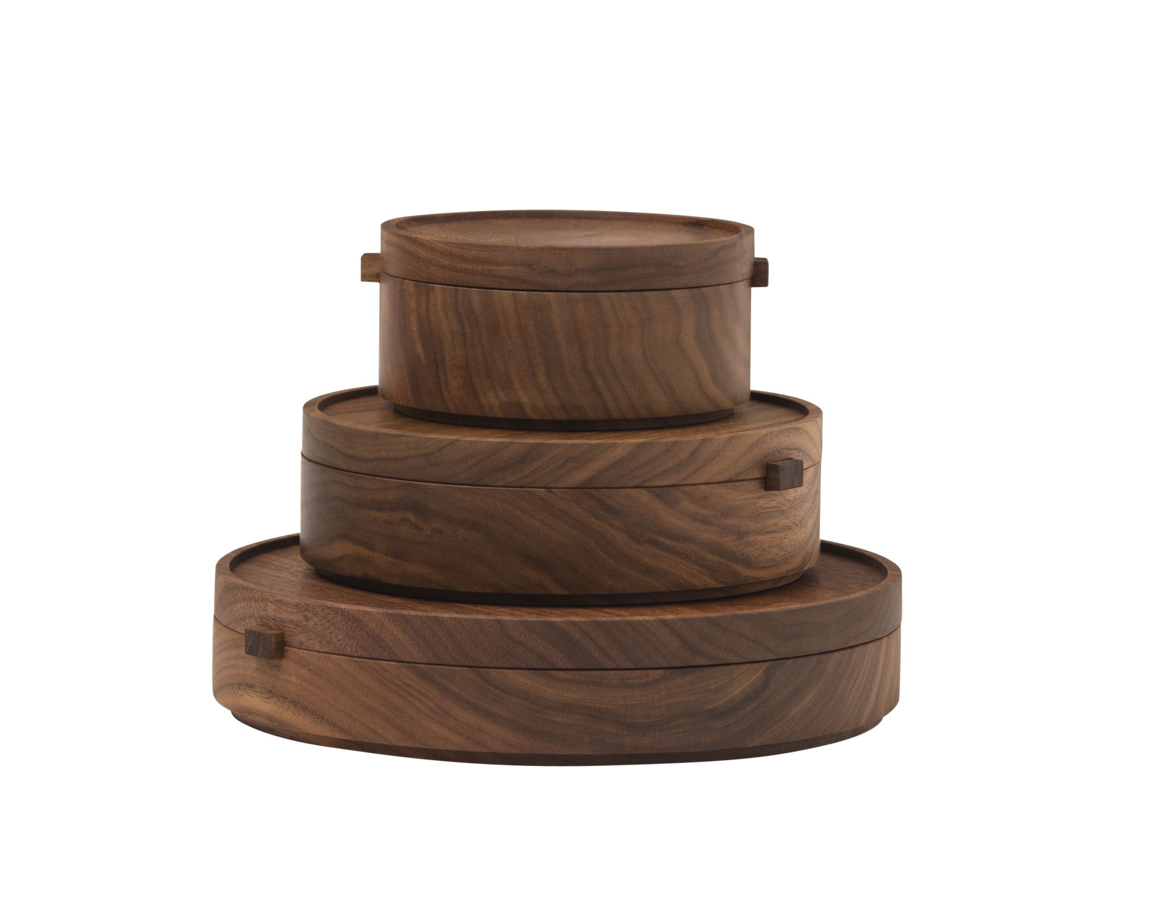 Stacks (2015) Thos. Moser Former professor Tom Moser left academia in 1972 to become a full-time woodworker, sourcing wood from the United States only. Today his furnishings company, based in Auburn, Maine, employs scores  of people. One set of Stacks boxes takes two weeks to complete.