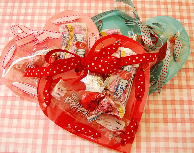Valentines made from card stock, clear vinyl and ribbon and stuffed with treats.