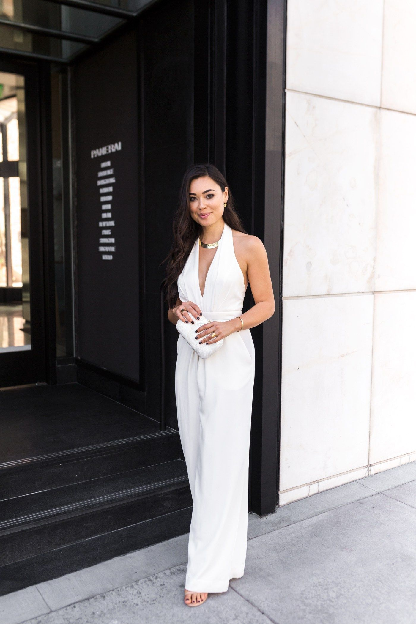 12d53936185 I love the idea of wearing a white jumpsuit wedding outfit for a rehearsal  dinner