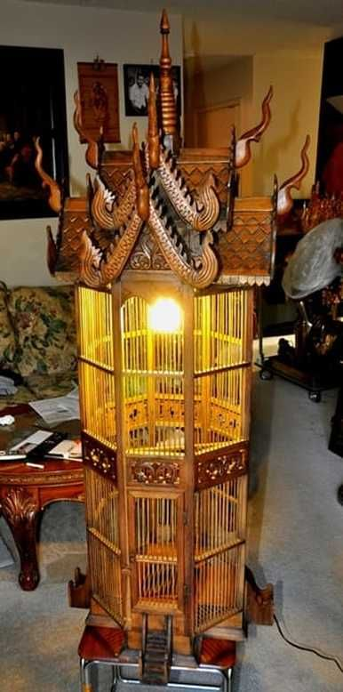 Thai handcrafted teak decorative bird cage of octagonal shape with lamp
