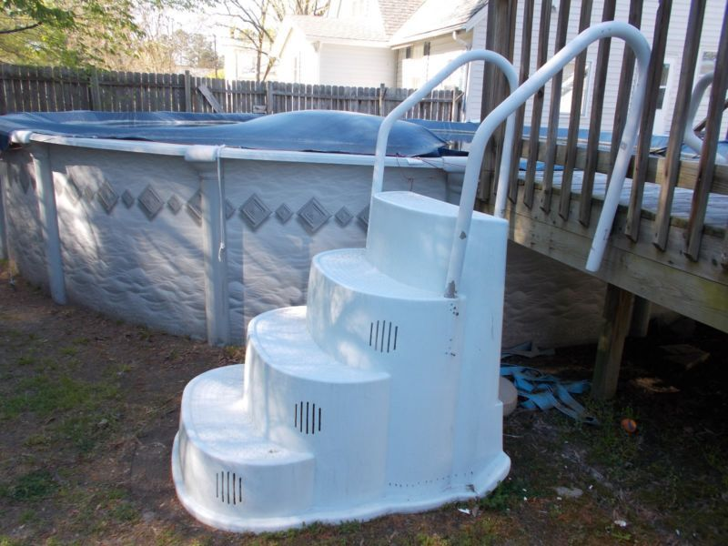 above ground wedding cake style pool steps with handrail
