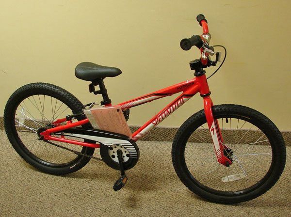 20 Child S Red Bicycle Donated By Motion Makers Bike Shop Specialized Boy S Hotrock 20 Coaster Is An Easy Way For Little Red Bicycles Bike Ride Bike Shop