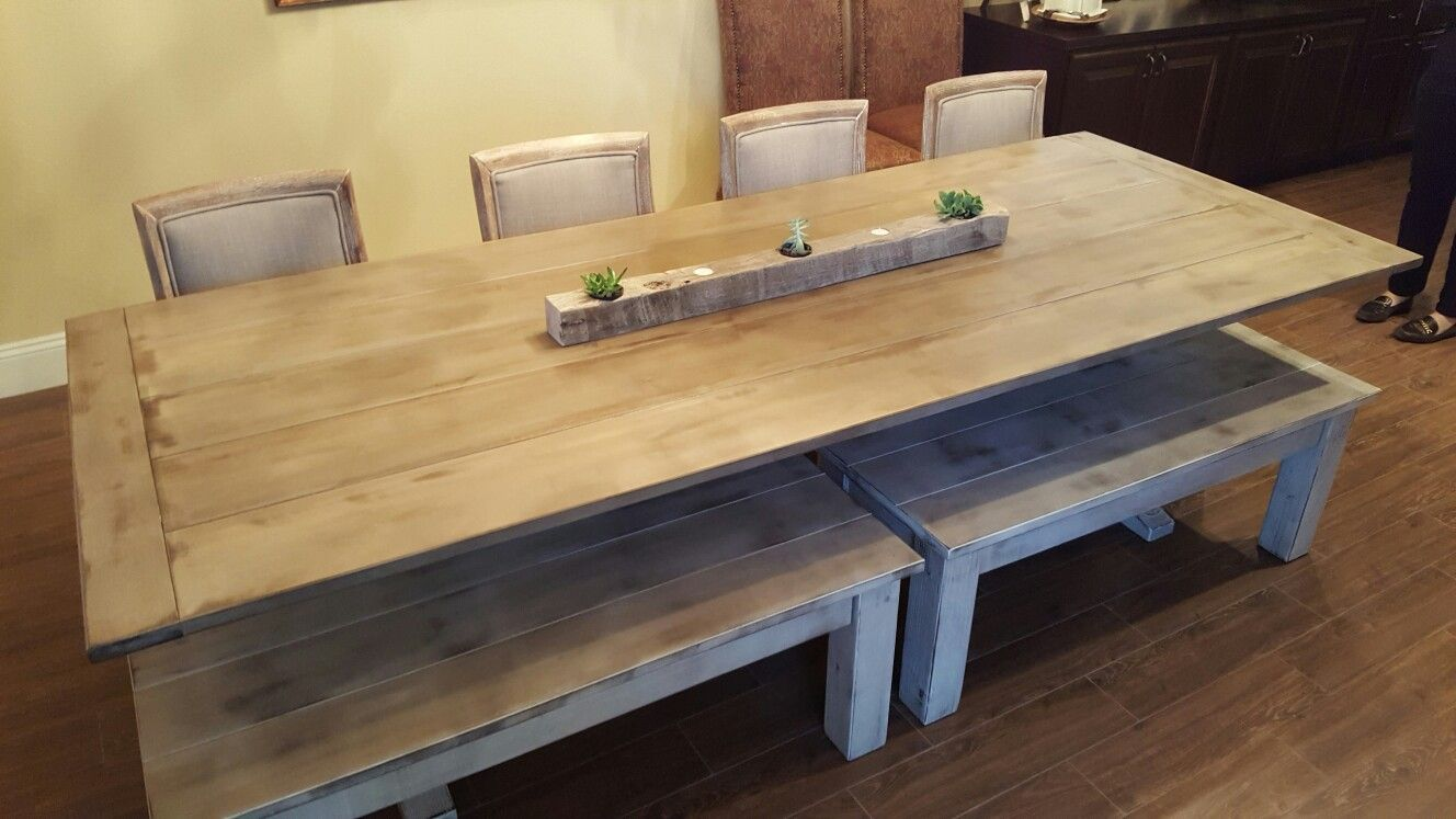 Farmhouse style table with benches containing storage