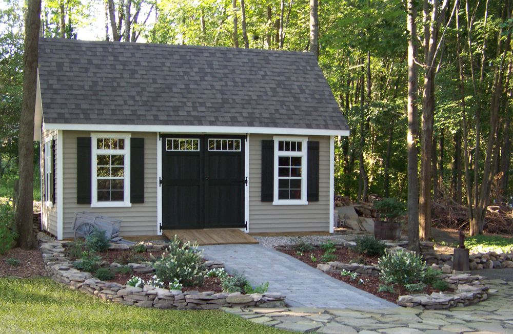 See How This Customer Landscaped Around Their 12 X 20 Vinyl Elite Cape Notice The Detail Of The Transoms Abov Shed Landscaping Outdoor Sheds Building A Shed
