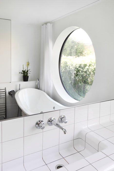 Small Round Windows: Jimi House Has A Large Round Window Inspired By Abstract