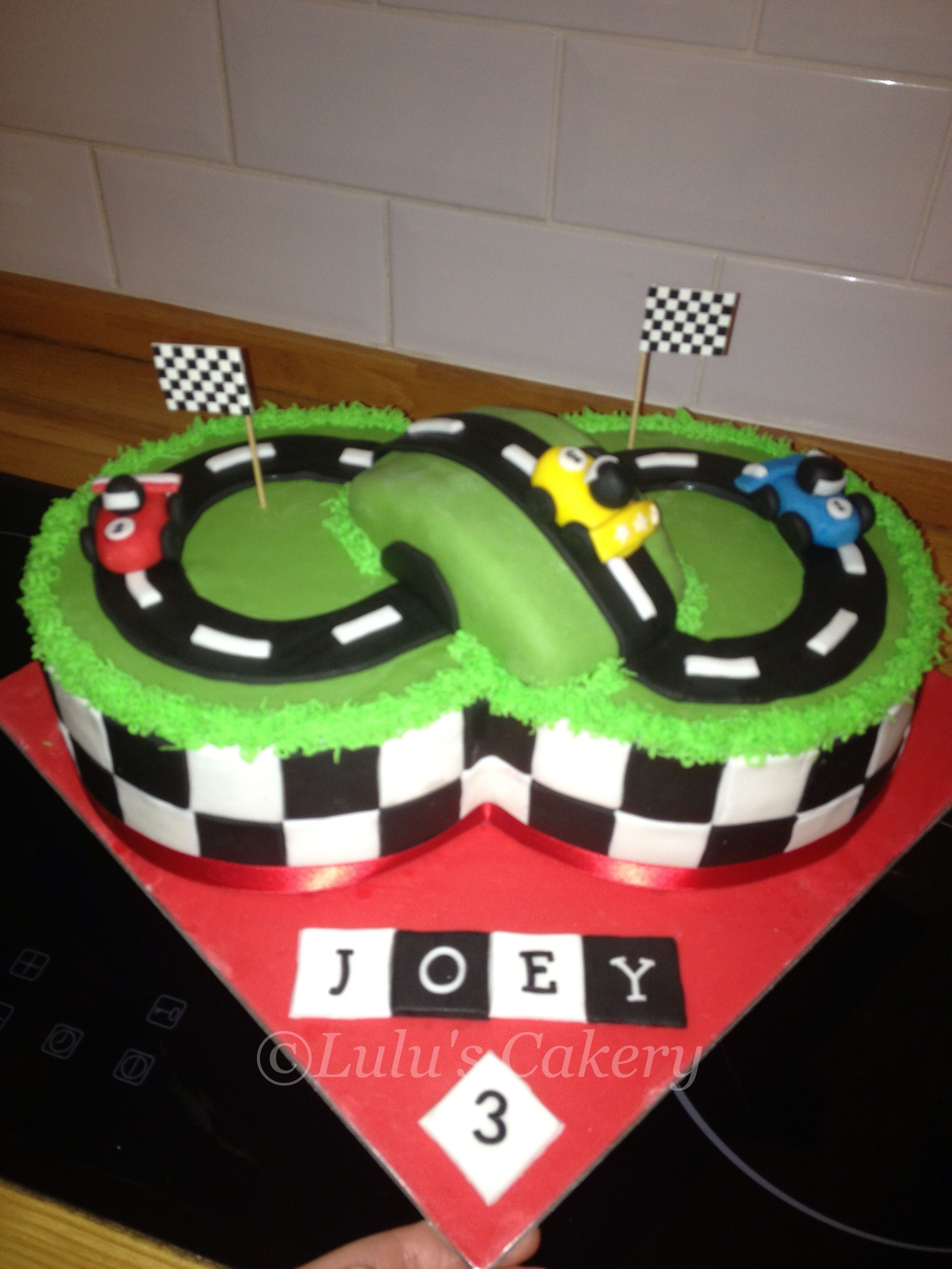 Half vanilla and half chocolate cake. Racing track cake for my little boys party x