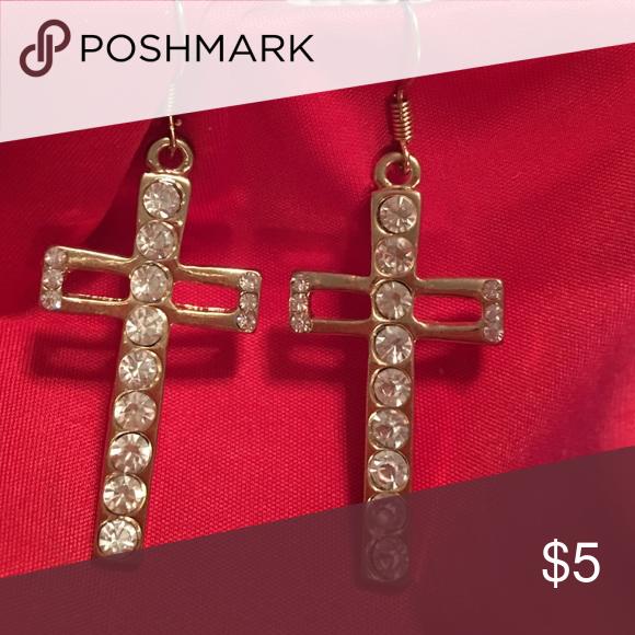Cross earrings Cross earrings has 9 crystals down the middle off each one. Jewelry Earrings